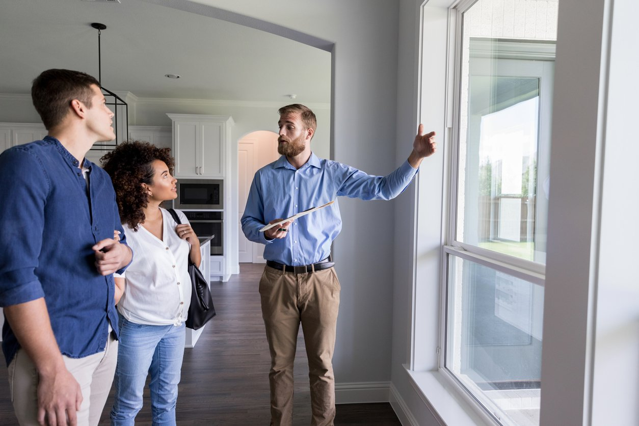 Couple working with a property management team to help landlords and investors feel at ease and tenants feel right at home.